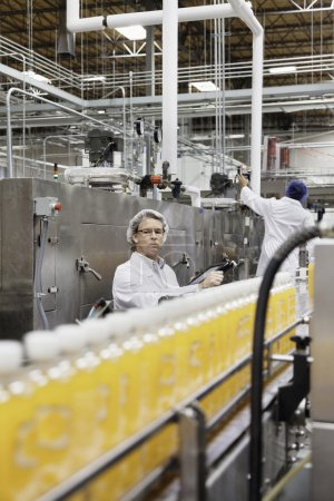 men working in bottling plant