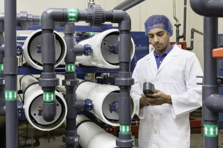 Worker in bottling plant