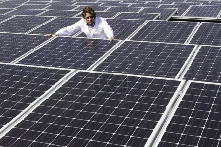 worker near solar panels