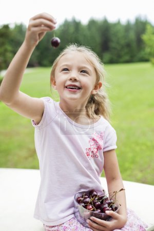 Happy girl  with cherries