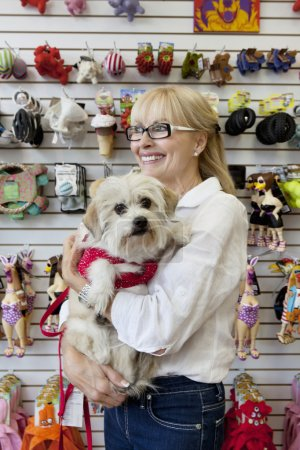 Senior pet shop owner