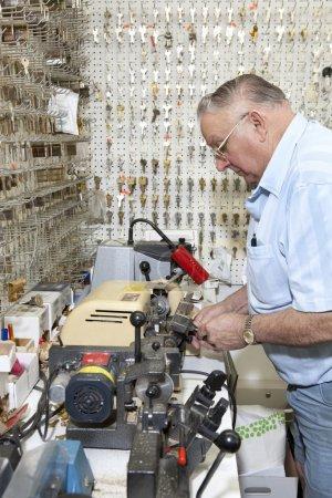 Senior locksmith  in hardware store