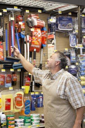 Mature  salesman in hardware store