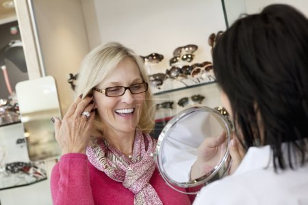 Cheerful senior woman with optician