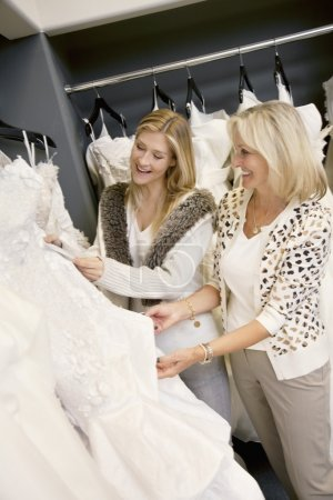Daughter and mother  in bridal boutique