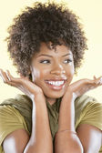 Happy African American woman looking away over colored background