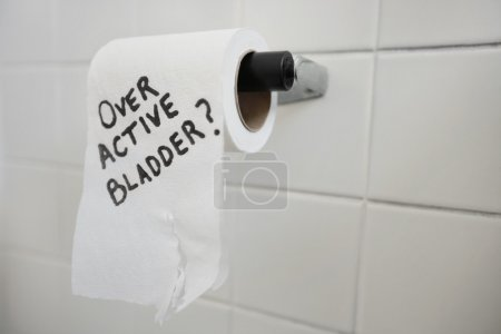 Close-up of toilet paper roll with text asking about bladder issues