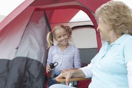 senior woman and girl  in tent