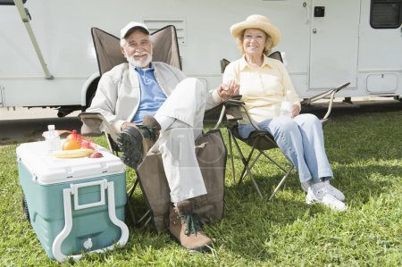 Relaxed Couple Sitting In Folding Chairs