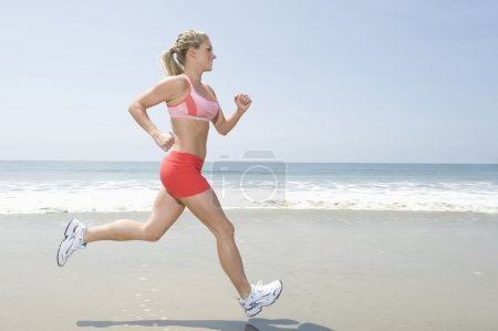 Woman Jogging At Beach