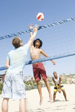 Men Playing Volleyball At Beach