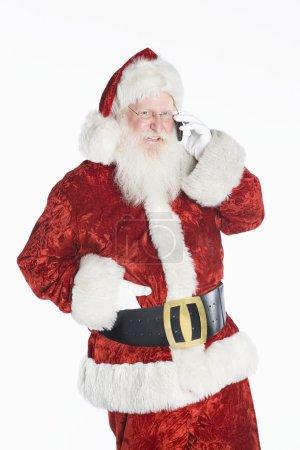 Santa Claus Using Cell Phone