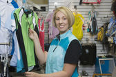Woman Shopping For Sports Clothing In Shop