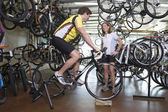Couple Buying Bicycle At Shop