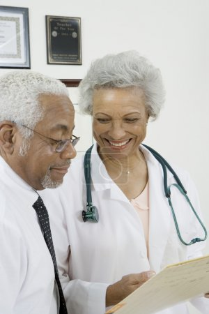 Doctors with Document In Clinic