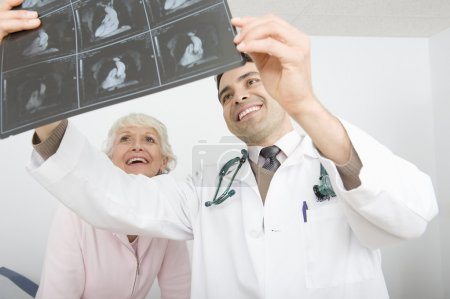 Doctor Explaining X-Ray To Patient