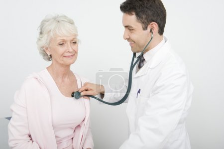Doctor Checking Patient's Heartbeat Using Stethoscope