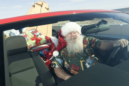 Father Christmas In Convertible With Surfboard