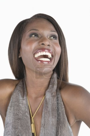 Fashion Model In Grey Halterneck Dress Laughing