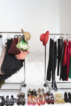 Trendy Footwear And Hats With Accessories On Clothes Rail