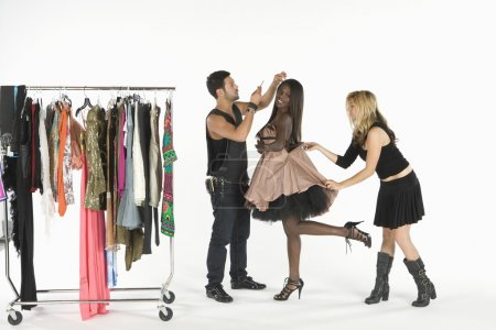 Fashion Model With Artists Adjusting Her Outfit