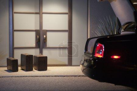Suitcases At Doorway