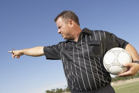 Referee With Soccer Ball Pointing