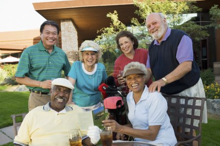Photo for Group portrait of happy multiethnic enjoying at a golf resort - Royalty Free Image