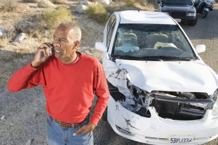 Senior Man On Call With Damaged Car In The Background
