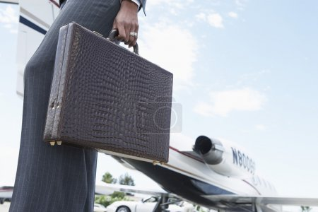 Businesswoman With Briefcase At The Airport