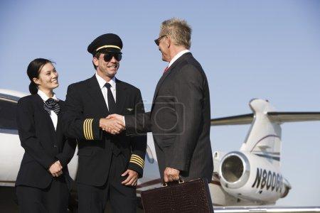 Senior Businessman Thanking Airplane Captain