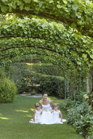 Girls And Bride Squatting Under Ivy Arches