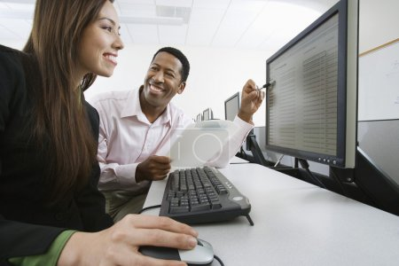 Man And Woman Working Together In Computer Lab