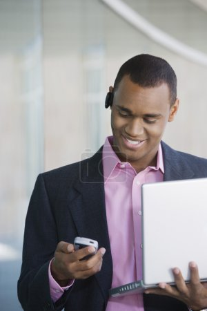 Businessman Reading Message On Mobile Phone