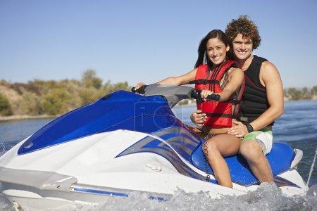 Happy Couple Riding PWC