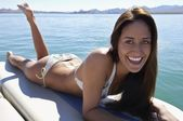 Woman Relaxing On Boat