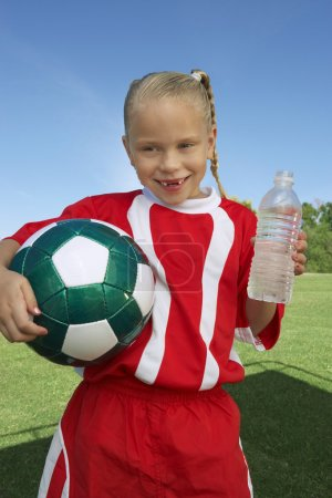 Soccer Player Holding Water Bottle