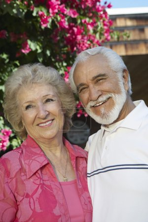 Photo for Portrait of a happy senior man with wife standing outdoors - Royalty Free Image