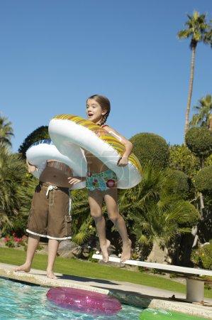 Girl Jumping In Swimming Pool