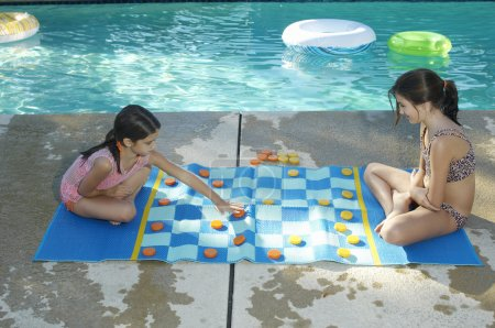 Girls Playing Large Draughts Board