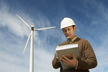 Engineer Working At Wind Farm