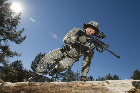 Soldier Jumping Over Log