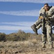 US Army soldier carrying wounded friend on shoulde...