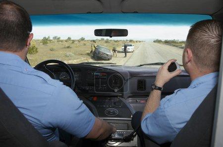 Paramedics Arriving At Car Crash Scene