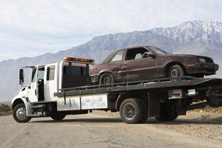 Broken Car On Tow Truck
