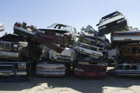 Stacked Cars In Junkyard