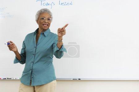 Teacher Explaining In The Classroom