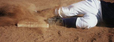 Player Sliding Towards Base On Field