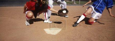 Players Playing Baseball On Field