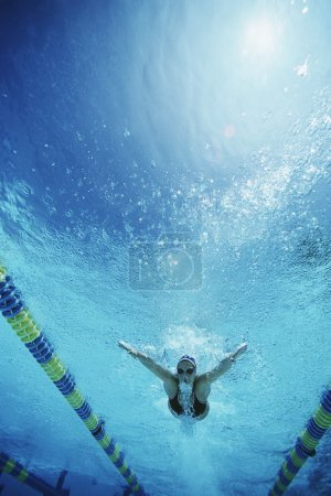 Professional female swimmer practicing